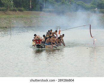YILAN TAIWAN - June 20: rower set off fireworks to pray for peace and safe. Erlong River Dragon Boat Race on the Erlong River on June 20, 2015 in Yilan