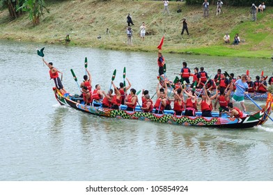 "YILAN TAIWAN - JUNE 23: ""flag fetcher� snatched the flag at the end point. Erlong Dragon boat racing festival on the Erlong River on June 23, 2012 in Yilan"