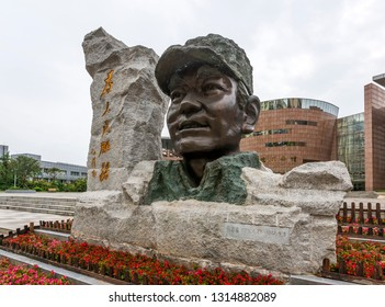 Yilong County,sichuang/china- July 11,2018:A statue in front of the zhang side memorial hall.Died unexpectedly while burning charcoal in yan 'an in 1944.MAO zedong wrote for him: serve the people.