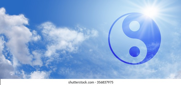 Yin Yang Blue Sky Banner -  Wide blue sky panorama with fluffy clouds and a bright sunburst behind a semi-transparent blue Yin Yang Symbol