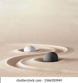 yin and Yang symbol of dualism in ancient Chinese philosophy where opposite or contrary forces are complementary. Like light and dark or fire and water, male and female. A black an white round stone