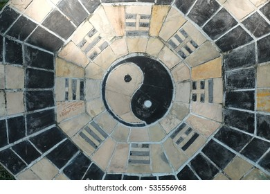 yin yang symbol on tiled wall