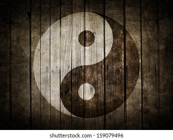 The Ying Yang sign painted on wooden wall