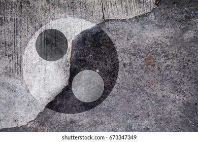 Ying Yang symbol on cracked concrete