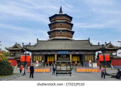 """Yingxian / China - Oct 2019: Wooden Pagoda of Buddha Shakyamuni in Yingxian town, near Datong in Shanxi province. Translation is """"Pagoda of Buddha Shakyamuni""""."""