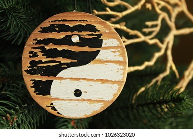yin-yang. image of yin-yang on a blue background. Sign of yin-yang on Christmas tree as a Christmas tree decoration