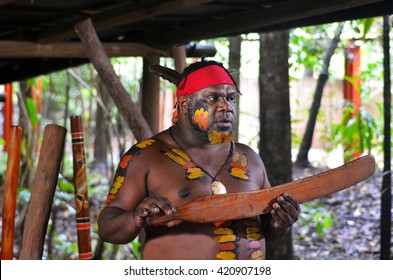 Yirrganydji Aboriginal warrior explain about Native Australian martial arts tools during cultural show in Queensland, Australia.