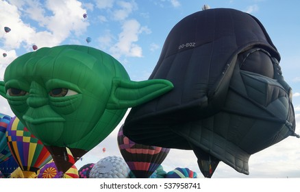 Yoda and Darth Vader:  October 3, 2015, Albuquerque International Balloon Fiesta. Yoda and Darth Vader hot air balloons are getting ready to take flight.