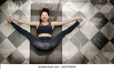 Yoga activities of Asian women Can play inside the house And play at any time For good health and weight loss in order to have beautiful shape Suitable for people of all ages Good health care concept