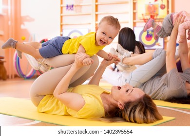 Yoga for babies. Child-friendly fitness for women with kids toddlers. Lifestyle concept of parent activity with children.