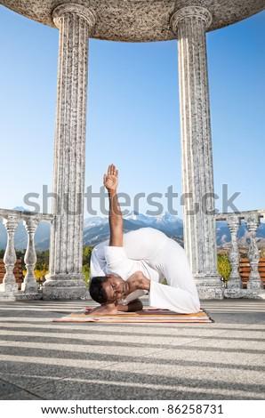 yoga bal krishnasana difficult posestock photo (edit now