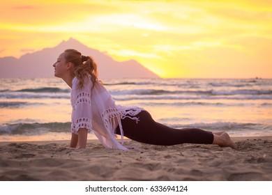 Yoga at the beach at sunrise