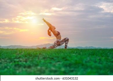 YOGA : Beautiful young woman doing yoga in the summer park. Healthy lifestyle. Various yoga postures.