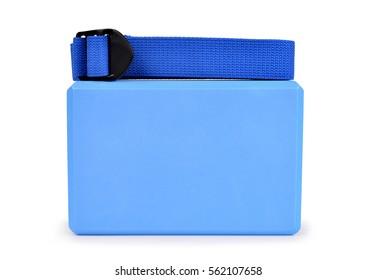 Yoga block and belt isolated on white background.