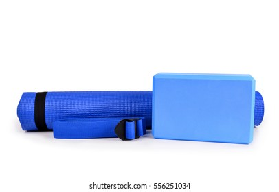 Yoga blocks belts and mat props isolated on white background.
