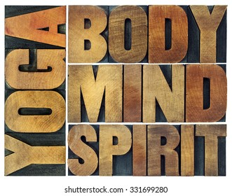 yoga, body, mind, soul and spirit word abstract - a collage of isolated text in vintage wood letterpress printing blocks