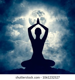 Yoga Body Pose Silhouette over Moon Night Sly, Mindfulness Meditation Exercise in Prayer Position