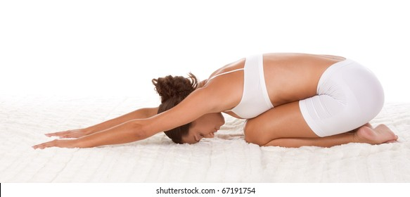 """yoga """"Child's Pose"""" - female in sport clothes performing exercise"""