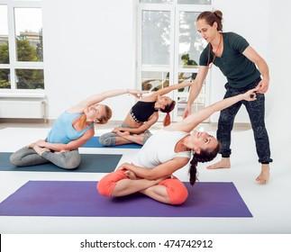 Yoga class in fitness studio