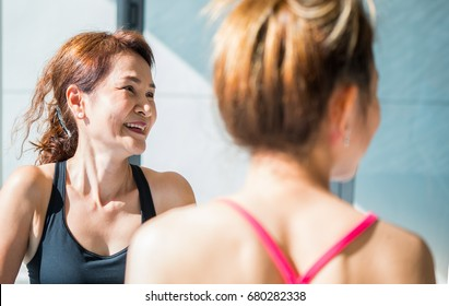 In yoga class Older woman smiling happily.