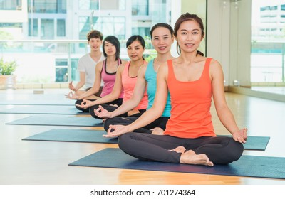 Yoga class in studio room,Group of people doing lotus pose with clam relax emotion,Meditation pose,Wellness and Healthy Lifestyle