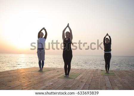 yoga class three people womans man stock photo edit now 633693839