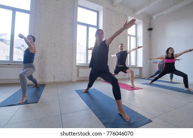 yoga class training, morning exercises in white interior