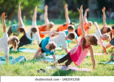 Yoga classes outside on the open air. Kids Yoga