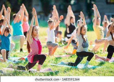 Yoga classes outside on the open air. Kids Yoga