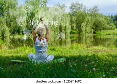 Yoga classes Two girls sitting in the lotus position, practicing yoga outdoors, the idea of biohacking