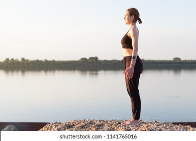 yoga concentration and breathing excercise next to the river