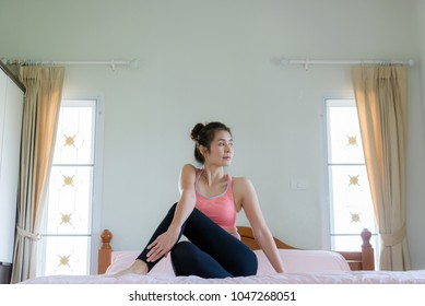 yoga concept, woman wearing sportwear yoga on bed at home