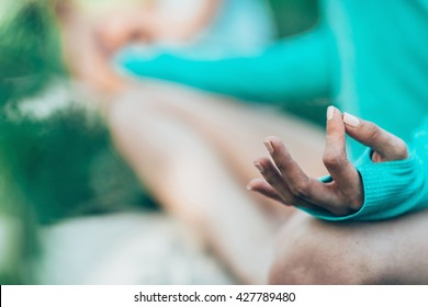 Yoga detail, lotus position mudra.