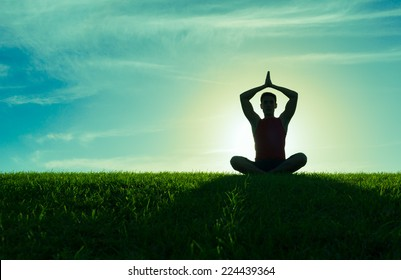 Yoga and fitness. Silhouette of man meditating