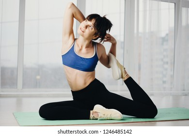 yoga, fitness, sport, active lifestyle, flexibility, healthy spine, harmony. fit woman doing static stretching exercise at yoga studio