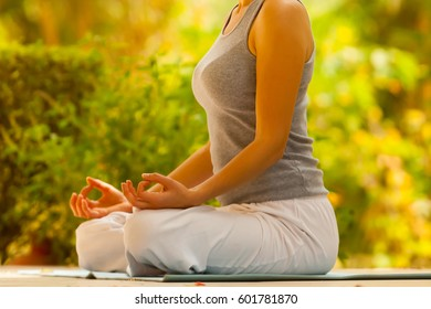 yoga girl in the Indian summer park pose meditation