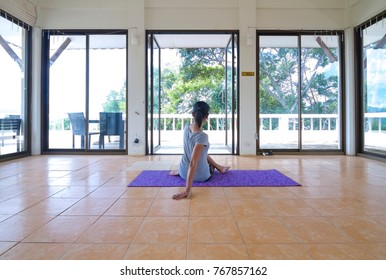 Yoga girl in a large room Natural environment
