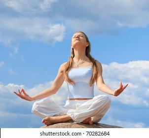 Yoga girl on a beach