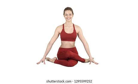 Yoga girl practicing nadi shodhana pranayama or Breathingin in gomukhasana asana or cow head pose on white background.