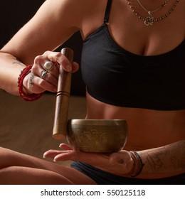 yoga girl with tattoo do asana on black background sitting in meditation pose  yoga