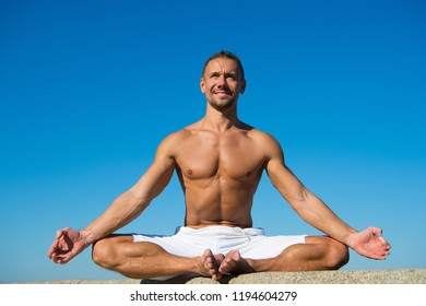 Yoga helps find balance and unite with nature. Yoga practice helps find harmony and balance. Man practicing yoga blue sky background. Reached peace of mind. Meditation and yoga concept.