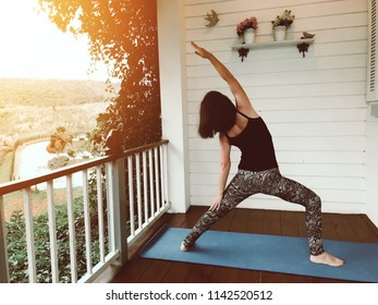 Yoga at home, keep clam, attractive young woman exercise stretching on yoga mat at home with natural view