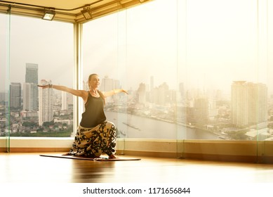 A yoga master practicing yoga performing a stand pose streching