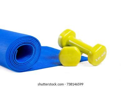Yoga mat and dumbbells. Isolated on white background