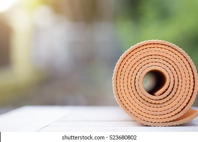 yoga mat on the table in a garden