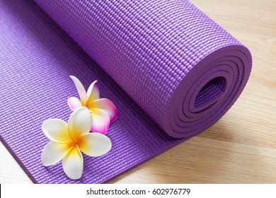 yoga mat on wood floor