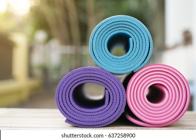 yoga mat on the wooden table