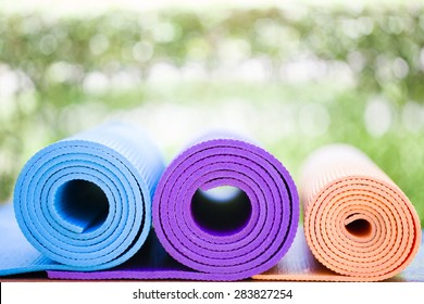 yoga mats on the table in a garden