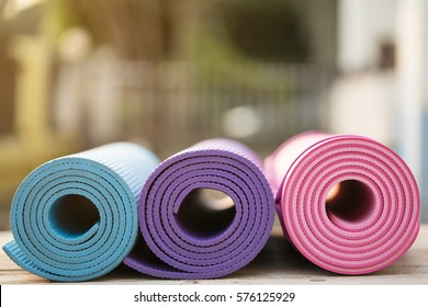 yoga mats on wood table with sunlight