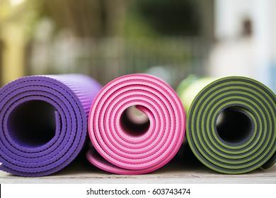 yoga mats on the wood table